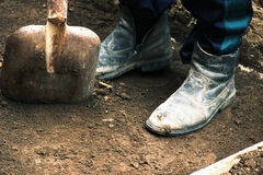Install the formwork and remove the top layer of the ground by digging a pit or trench. Independent concreting of the. Site or track. A man in dirty shoes is Royalty Free Stock Image
