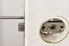 Install latch with a screwdriver on the door. Royalty Free Stock Images