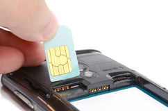 Install sim card. Into a cellphone Stock Photography