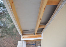 Install Soffit. Roofing Construction. Soffit and Fascia is Usually Constructed of Vinyl, Wood or Aluminum. Royalty Free Stock Photos