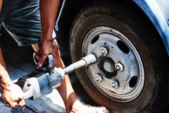 repair  car and install  wheel nut Stock Photo