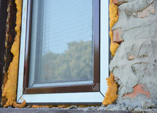 Install Window insulation with spray foam insulation for energy saving. Royalty Free Stock Photos
