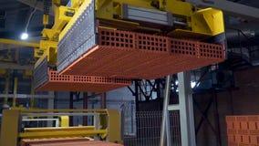 Installatie voor de productie van bakstenen Installatie voor productiebouwmateriaal met klaar baksteen, industriële bouw royalty-vrije stock foto