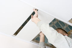 Installation. Plastic profile on ceiling Stock Image