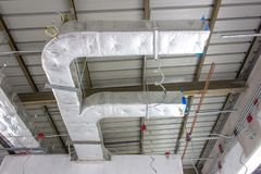Installation of air conditioning system,Bare skin ceiling royalty free stock images