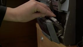 Installation of an audio cassette in a tape recorder in a broadcasting studio. Close-up stock video footage