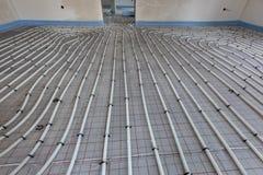 Installation av underfloor uppvärmning arkivfoton