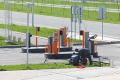 Power engineers lay the power cable to the automatic barriers. royalty free stock image