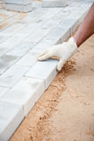 Installation of brick platform - laying bricks Stock Photo