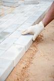 Installation of brick platform - laying bricks Stock Photo