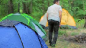Installation of camping in a mountain forest in stock video footage