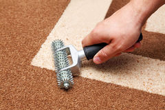 Installation of carpet Stock Photography