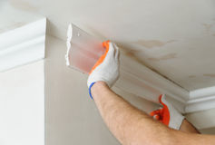 Installation of ceiling moldings. Royalty Free Stock Photo