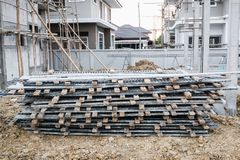 Installation of cement formwork frames to new house construction. At building site, real estate development Royalty Free Stock Images