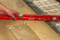 Installation of ceramic tiles and heating elements in warm tile Stock Photos