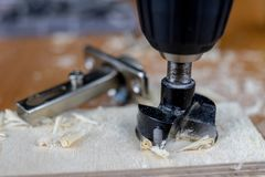 Installation of chipboard furniture in a carpentry workshop. Acc royalty free stock images