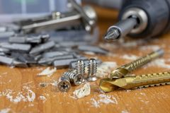Installation of chipboard furniture in a carpentry workshop. Acc royalty free stock photos