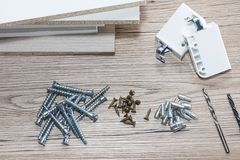 Installation of chipboard furniture in a carpentry workshop. Accessories and tools for carpenters. / stock photo