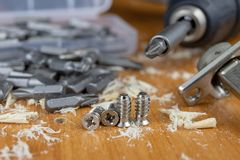 Installation of chipboard furniture in a carpentry workshop. Accessories and tools for carpenters. stock photo
