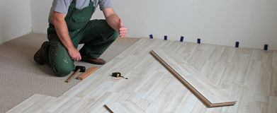 Installation from click laminate. Flooring stock photography