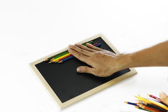 Installation of colored pencils and black board. Back to school, back to work Royalty Free Stock Images