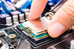 Installation computer chip. Computer main processor socket with CPU on the motherboard, view close-up Stock Images