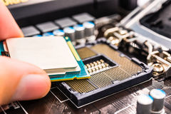 Installation of computer processor in the socket Stock Photo
