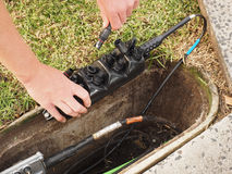 Installation of a customer connection drop cable into a Multiport Stock Image