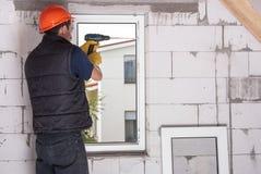 Installation des fenêtres en plastique Photographie stock libre de droits