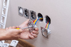 Installation of electrical sockets stock photo