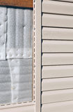 Installation on facade panels beige vinyl siding Royalty Free Stock Photography