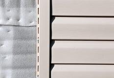 Installation on facade panels beige vinyl siding Stock Photography