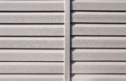 Installation on facade panels beige vinyl siding Stock Image