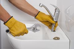 Installation of a faucet for a sink royalty free stock image