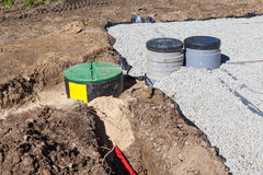 Installation of the filters and pump on a gravel filter bed Stock Photos