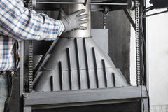 Installation of fireplace chimney. Chimney installation on modern cast iron fireplace stock image