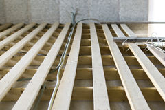 Installation of floor lags and cables. In house under construction Royalty Free Stock Photography