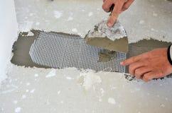 Installation of Floor Tiles Stock Photo