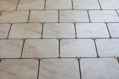 Installation of floor tiles and spacers Stock Images