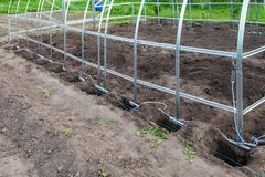Installation of frame greenhouse outdoors Stock Photography