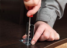 Installation of furniture fittings, mounting bracket for the sli Royalty Free Stock Image