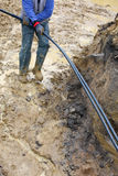 Installation of geothermal pipes in the ground Stock Photos