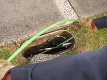 Installation of  a green  72 fiber optic ribbon cable in a cable duct Stock Images