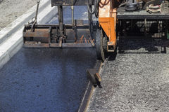 Installation of hard and cast molten asphalt 2 Stock Photo