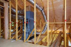 Installation of heating system on the roof of the pipe system of heating closeup. Home construction with installation of heating system on the roof of the pipe stock photography