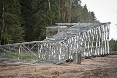 Installation of high-voltage tower. In the forest Stock Photo
