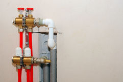 Installation individual of home heating. Connecting pipe warm water floor to the manifold heating. Royalty Free Stock Photos