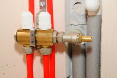 Installation individual of home heating. Connecting pipe warm water floor to the manifold heating. Stock Photos