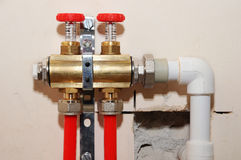 Installation individual of home heating. Connecting pipe warm water floor to the manifold heating. Royalty Free Stock Image