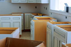 Installation of kitchen. the drawer in cabinet. Installation of kitchen cabinets the drawer in cabinet stock photos
